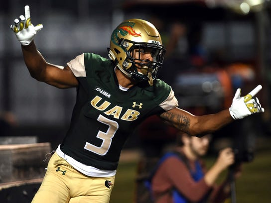 FILE - In this Oct. 14, 2017 photo, UAB wide receiver Andre Wilson celebrates his second-quarter touchdown against Middle Tennessee during an NCAA college football game at Legion Field in Birmingham, Ala. UAB's return to the football field after a two-year hiatus has been quite the adventure. The Blazers have lost on a two-point play in overtime and won with an end-of-game blocked field goal. (Mark Almond/AL.com via AP)