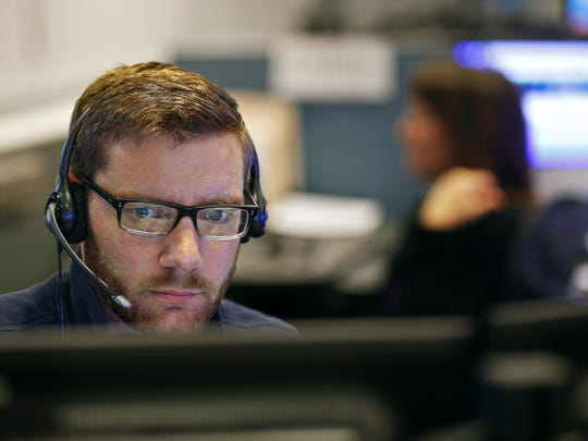 Emergency dispatcher Andrew Crocker during the overnight shift at the Springfield Greene County 911 Emergency Communications Department in Springfield.