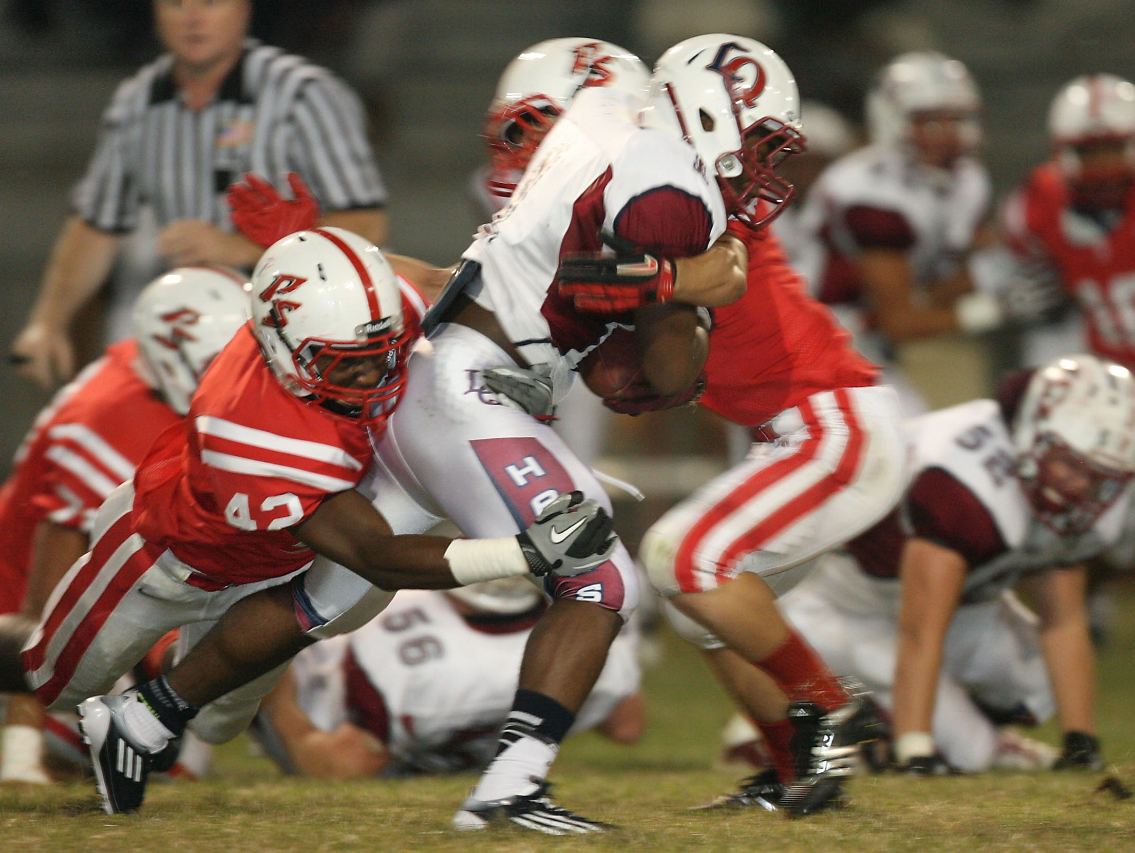 Rodney Butler, 42, makes a tackle on La Quinta running back Kenyon Williams during their game in Butler's senior season at Palm Springs. Butler is now looking to pursue a career in the NFL.