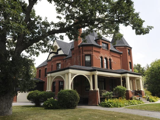 The red granite and pressed brick Queen Anne-style