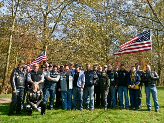 Denis Moyer Jr., his son Denis Moyer III and about two dozen motorcyclists stand for a group picture Saturday, Oct. 28, 2017, at the Interstate 83 welcome center in Shrewsbury Township. Denis Moyer Jr., a member of the Raised & Square Chapter of the Pennsylvania Widows Sons Masonic Riders Association, organized a bike ride to greet his son Denis Moyer III upon his arrival in Pennsylvania and to escort him back home in the Reading area. Denis Moyer III completed a tour in Iraq with the U.S. Army's 82nd Airborne Division and will ship out to Fort Carson, Colorado, in a month.