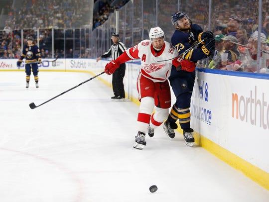 Red Wings defenseman Niklas Kronwall (55) checks Sabres