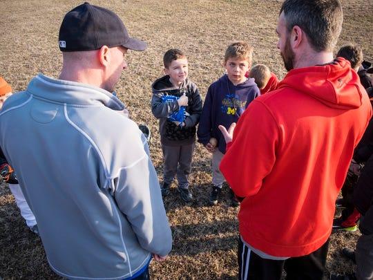 Port Huron Township Little League coaches Joe Moser,