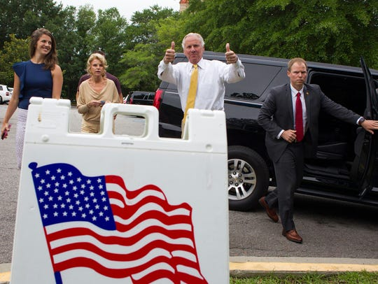 South Carolina Governor Henry McMaster gives a thumbs up as he arrives to vote in the South Carolina Primary  June 12, 2018, in Columbia, S.C. Arriving with McMaster is his daughter Mary Rogers, left, and wife Peggy, second from left.