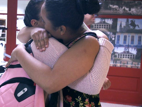 Rosa, left, is finally reunited with her sister Maria, whom she hasn't seen since January 2016. They met at Louis Armstrong New Orleans International Airport in Kenner, Louisiana, on June 29, 2018, after Rosa was released from detention in Denver. Rosa and her son, Juan, traveled to the United States from Honduras seeking asylum in May 2018. They were separated at the border.