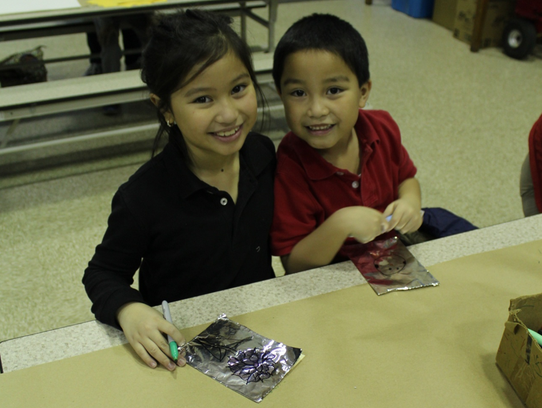 Abigail and Gabriel Logno work on an art activity during