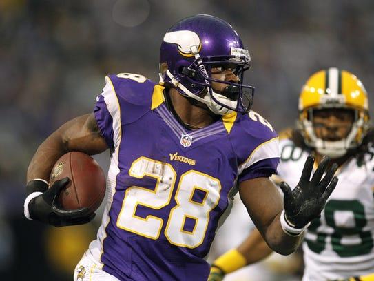 Minnesota Vikings running back Adrian Peterson, left,