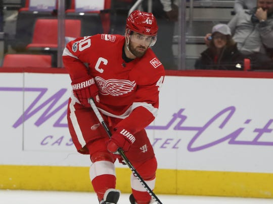 Red Wings forward Henrik Zetterberg brings the puck