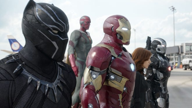 """From left, Chadwick Boseman as the Black Panther, Paul Bettany as Vision, Robert Downey Jr. as Iron Man, Scarlett Johansson as Natasha Romanoff, and Don Cheadle as War Machine in a scene from """"Marvel's Captain America: Civil War.""""  All of these superheroes are set to deal with the pandemic, except for Black Widow. (The Vision doesn't count. He's an artificial person.)"""