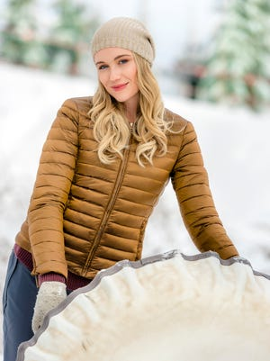 """Katrina Bowden stars as Alex, a copy editor for a travel magazine, who wants to be a writer in """"Love on the Slopes."""""""