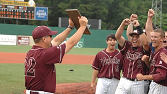 Hinds Community College head coach Sam Temple with his team in 2010.