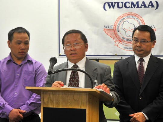 Wisconsin United Coalition of Mutual Assistance Association executive director Thai Vue, center, speaks about the results of a tobacco-use survey at the Hmong American Center in Wausau on Wednesday. At left is Xai Shoua Chang, who represents the Hmong American Association of Portage County; at right is Peter Yang, the executive director of Wausau's Hmong American Center.
