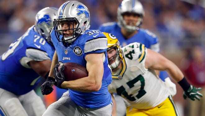 Detroit Lions fullback Zach Zenner rushes during the first half of an NFL football game against the Green Bay Packers, Sunday. Zenner scored a touchdown in the first half.