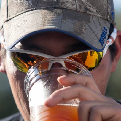 Alex Guilday of Fort Myers tries one of the beers at