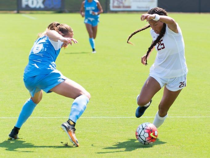 Florida State freshman forward Emily Madril(25) makes