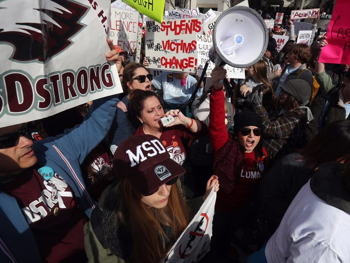 Students and adults with Marjory Stoneman Douglas High