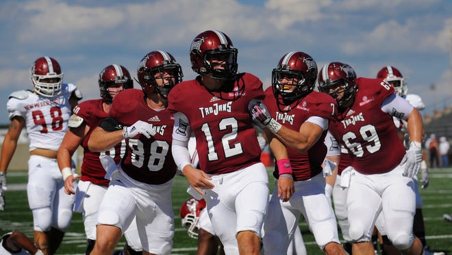 Troy University quarterback Brandon Silvers (12) is congratulated by teammates after scoring a first quarter touchdown against New Mexico State at Veterans Memorial Stadium in Troy, Ala. on Saturday October 11, 2014.
