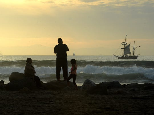 People gather and watch the Hawaiian Chieftain and Lady Washington conduct a three-hour battle sail viewed from Marina Park in Ventura in 2016.