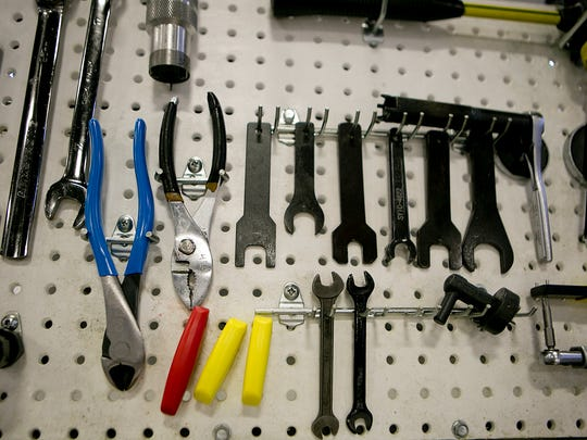 Tools hang in a work area at Pointe Precision in Plover,
