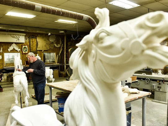 Wooden horses that have been carved and sanded are