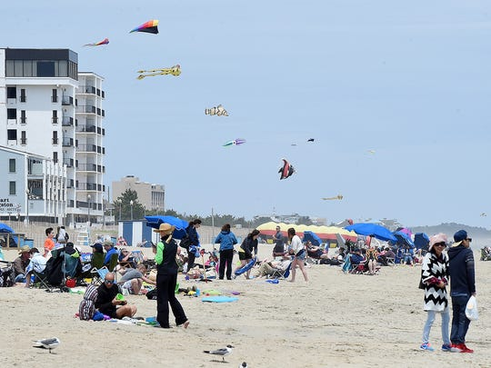 Cool and windy weather held back the beach crowds, the weekend before Memorial Day in Rehoboth Beach as the Annual Sidewalk Sale was held and visitors walked the Boardwalk.