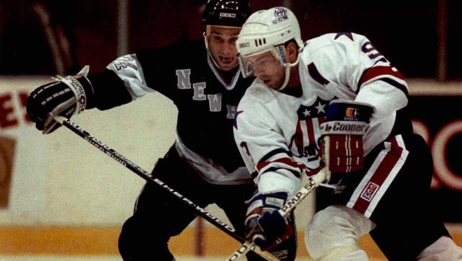 Jody Gage slices past New Haven defenseman Mike McEwen in a 1991 game.