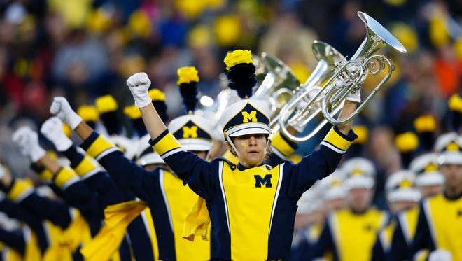 Michigan's marching band performs.
