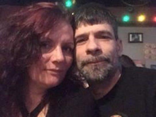 Christie Thornburg sits next to her boyfriend Ty Stoneburner,