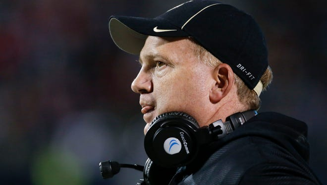Idaho football coach Paul Petrino watches his team play Mississippi during the second half of their NCAA college football game at Vaught-Hemingway Stadium in Oxford, Miss., on Saturday, Oct. 26, 2013. Mississippi won 59-14.  (AP Photo/Rogelio V. Solis)