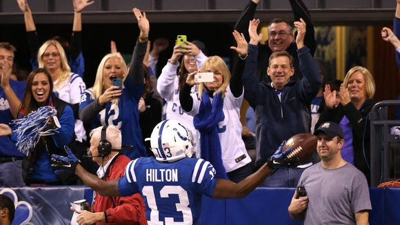 Colts fans react to T.Y. Hilton's first quarter touchdown against the Chiefs. The Indianapolis Colts hosted the Kansas City Chiefs at Lucas Oil Stadium Saturday, January 4, 2014.