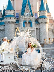 A bride arrives at her dream Disney wedding in Cinderella's Glass Coach.