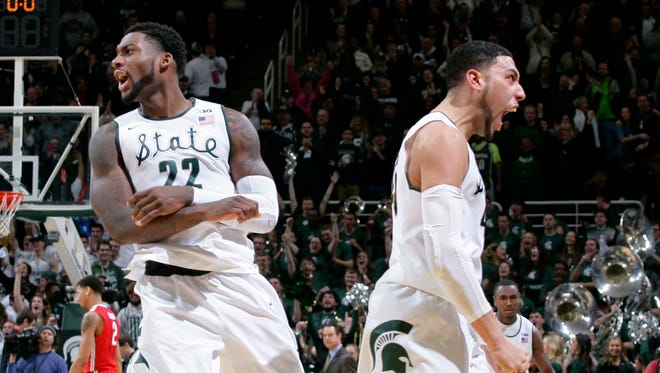 Michigan State's Denzel Valentine, right, and Branden Dawson (22) celebrate following a 59-56 win over Ohio State on Feb. 14, 2015.