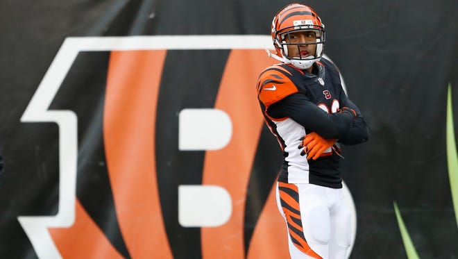Cincinnati Bengals safety Leon Hall poses after scoring a touchdown on an interception against the St. Louis Rams on Nov. 29, 2015, in Cincinnati.