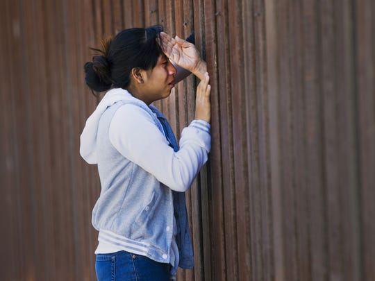 Fatima Rojas, 13 from Mesa, Arizona cries at the sight