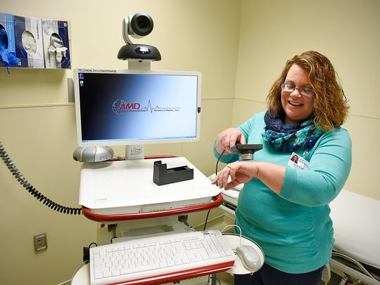 Sarah Zastrow, RN, shows a holdable camera that is part of the new equipment that will allow neurology consults with patients via telecommunications Oct. 28, 2015 at the Long Prairie Hospital.