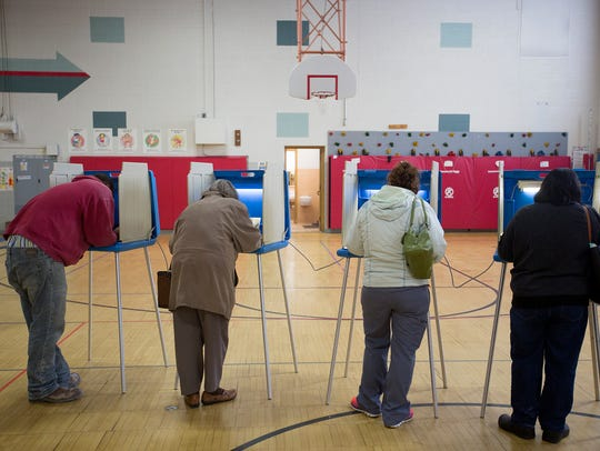 Voters cast their ballots in the spring election at