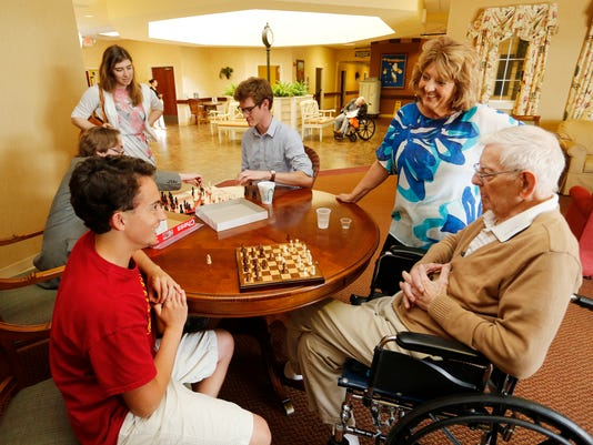 LAF McCutcheon students senior citizen bond over chess