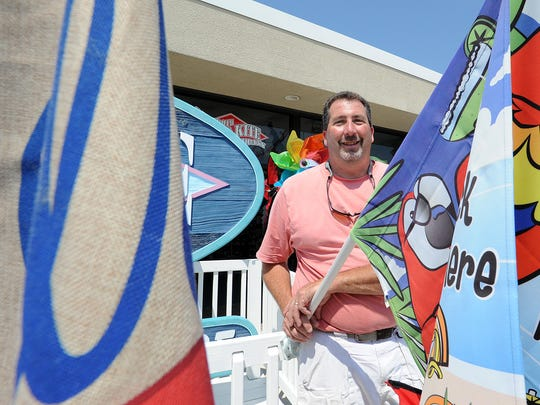 Rehoboth Toy & Kite owner Bee Linzey with his many kites and flags at his store on the boardwalk in Rehoboth Beach.