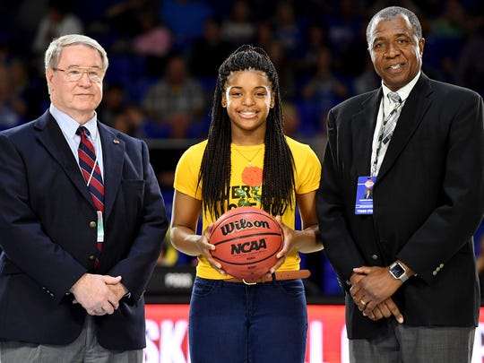 Haywood High School's Jamirah Shutes is presented with the game ball after she broke TSSAA records during her quarterfinal and semifinal games in the 2018 state tournaments, Thursday and Friday, March 8-9.