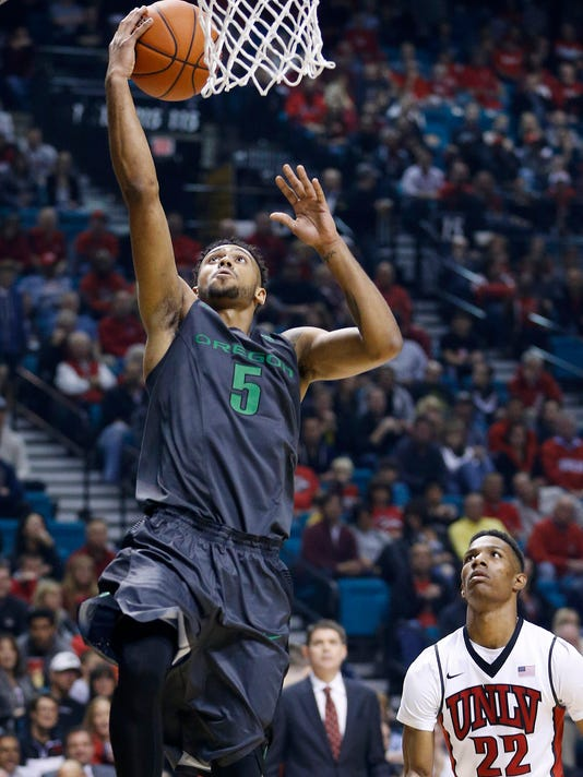 Oregon guard Tyler Dorsey shoots in front of UNLV guard Patrick McCaw during the first half of an NCAA college basketball game Friday, Dec. 4, 2015, in Las Vegas. (AP Photo/John Locher)