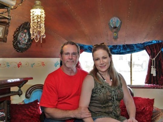 Harold and Elena Parker in their vintage trailer.