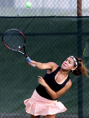 Becca Antrim from Loveland hits a shot during the Coaches Classic tennis tournament at Anderson High School.