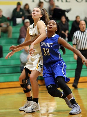 Summit guard Niah Woods and McNicholas guard Alyssa Herper battle for position for a rebound in the game between Summit Country Day and McNicholas High School at McNicholas. Summit Country Day defeated McNicholas 56-39.