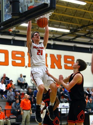 Anderson center Hunter Bode dunks in the boys basketball game between the Loveland Tigers and the Anderson Redskins at Anderson High School February 9, 2018.