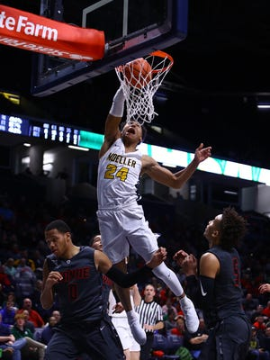 Moeller forward Jeremiah Davenport slams home two points in the OHSAA Regional Championship Final at Xavier University. Moeller defeated Wayne 65-53 and moves on to the OHSAA Final Four next week.