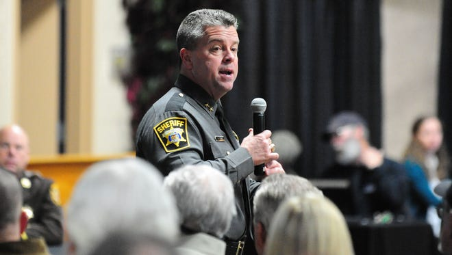 Wicomico County Sheriff Mike Lewis leads a town hall discussion on upcoming gun legislation at the Wicomico Youth & Civic Center on Monday evening.