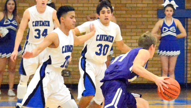 Carlsbad senior point guards Ralph Cueto (10) and Malachi Calderon (30) chase after Clovis senior guard Luke Bussen in the first quarter Tuesday.