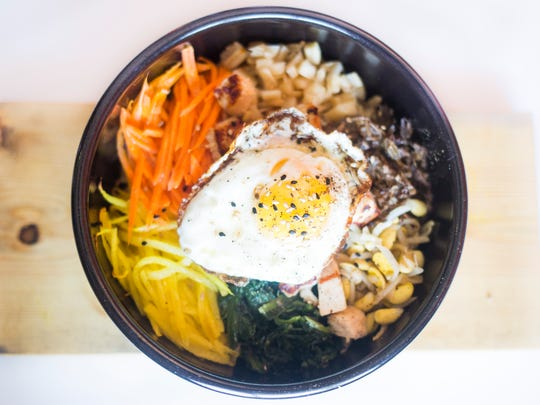 Yolk Asian Kitchen's Bibimbap with chicken is photographed