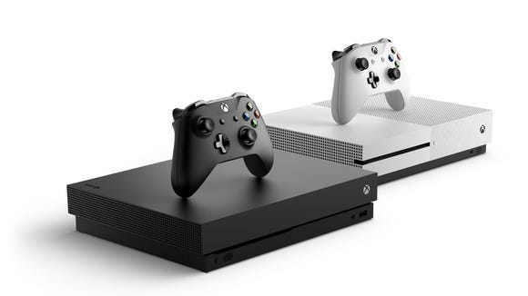 Microsoft Xbox One X (black) and One S (white).