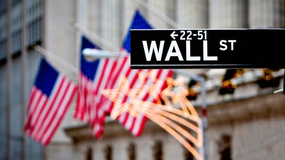 Wall Street sign with American flags in the background
